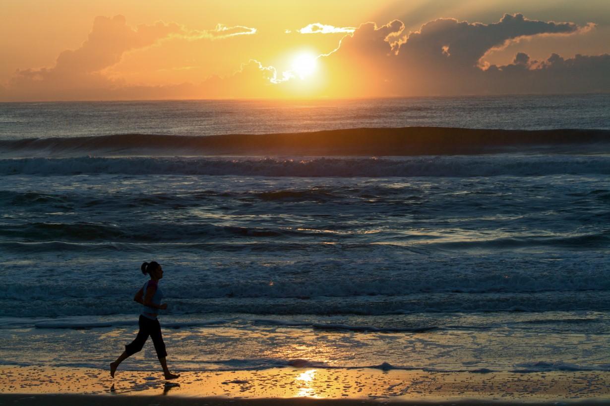 female runner dawn sunrise ocean