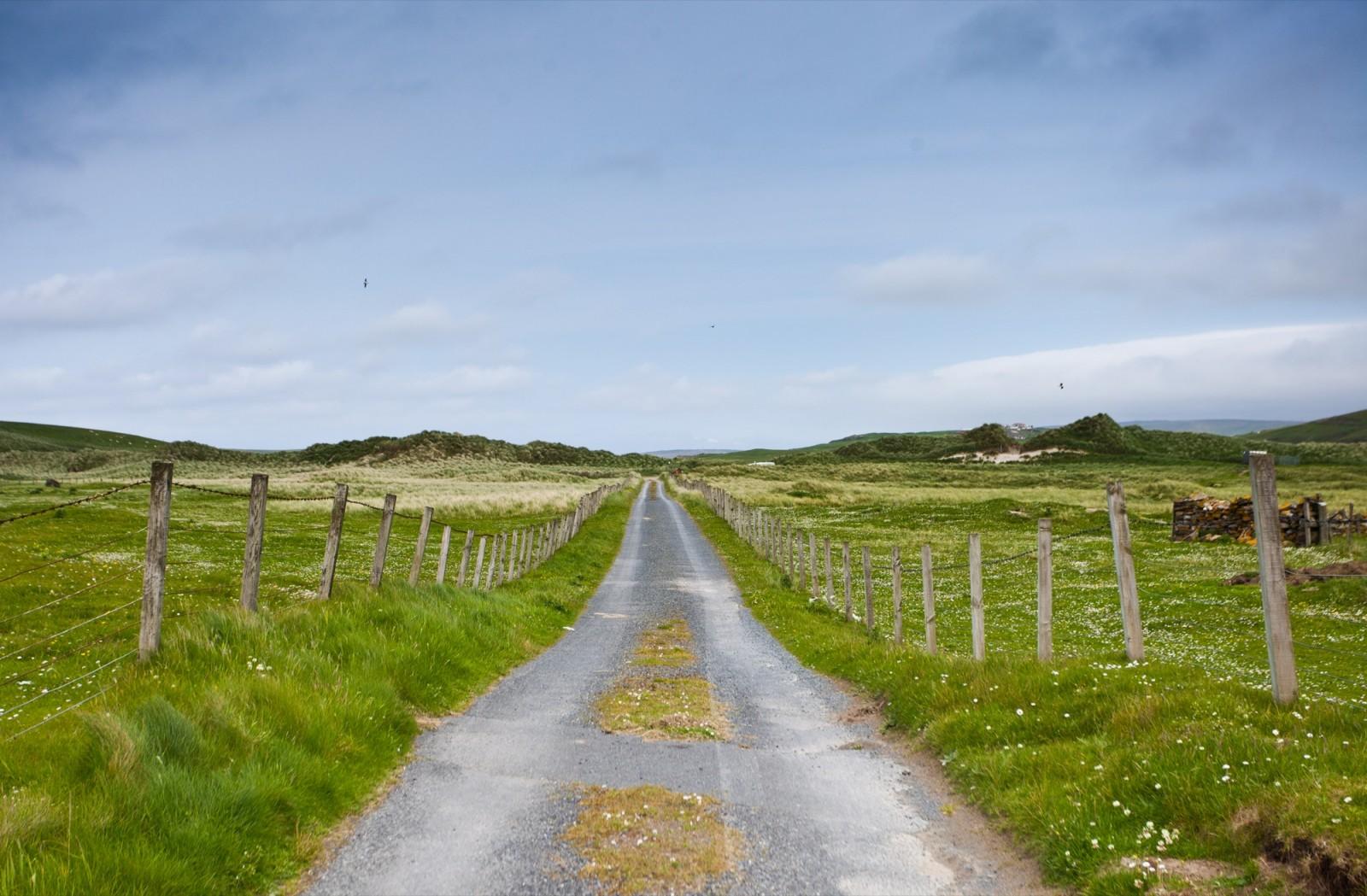 road track meadow sky shetlands