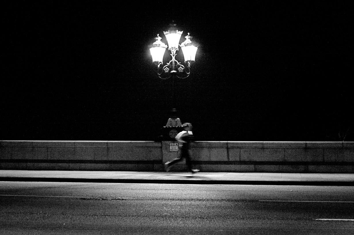 runner night street black and white